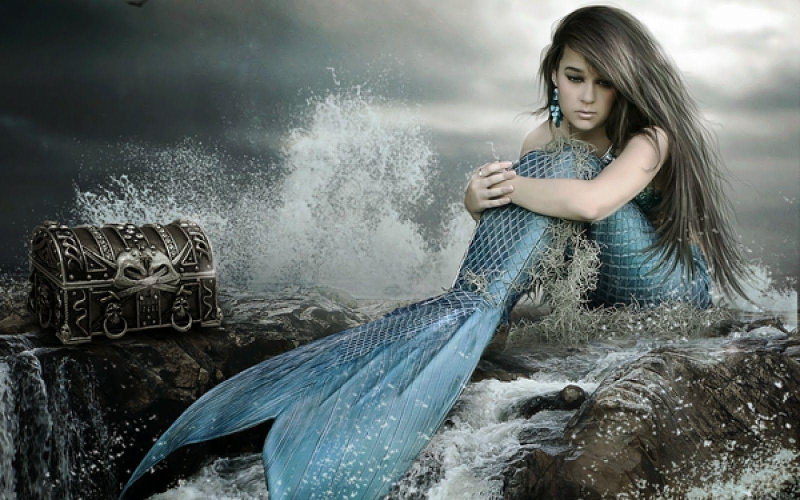 sad mermaid real with treasure sitting in beach image