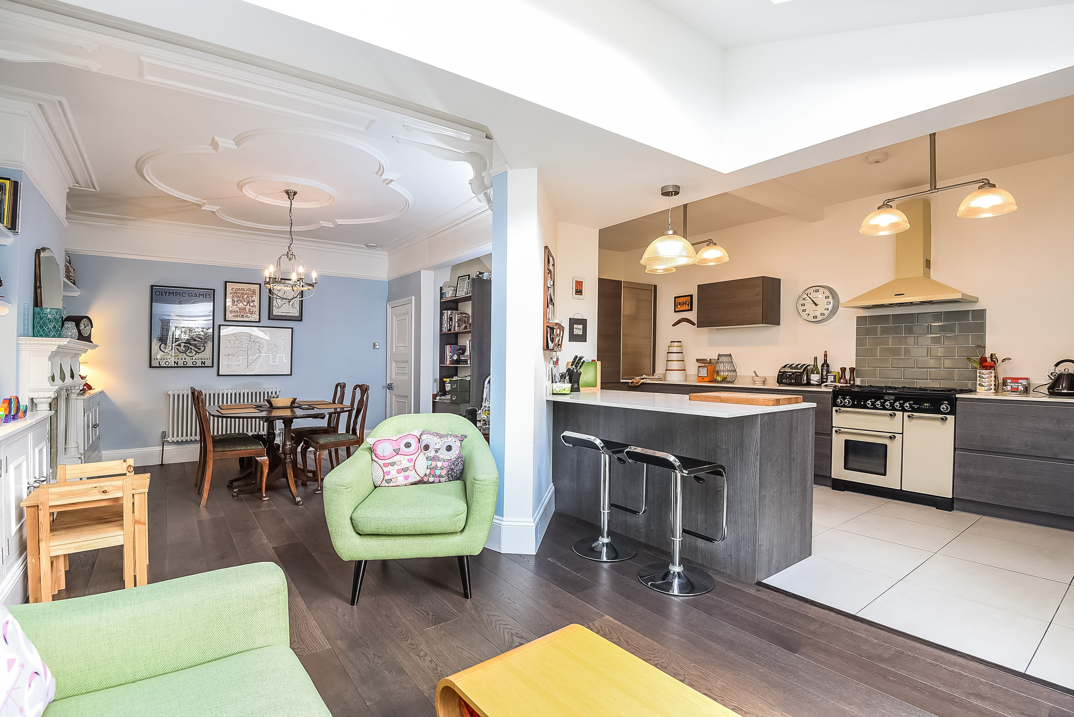 Green armchair, open plan kitchen/living/dining