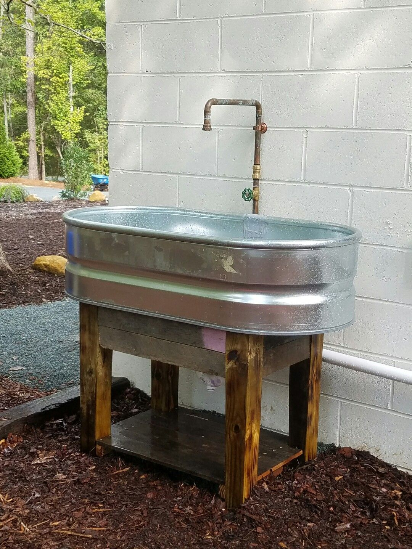 outdoor kitchen sinks lighting in stock tank sink pallet wood base pallets pinterest