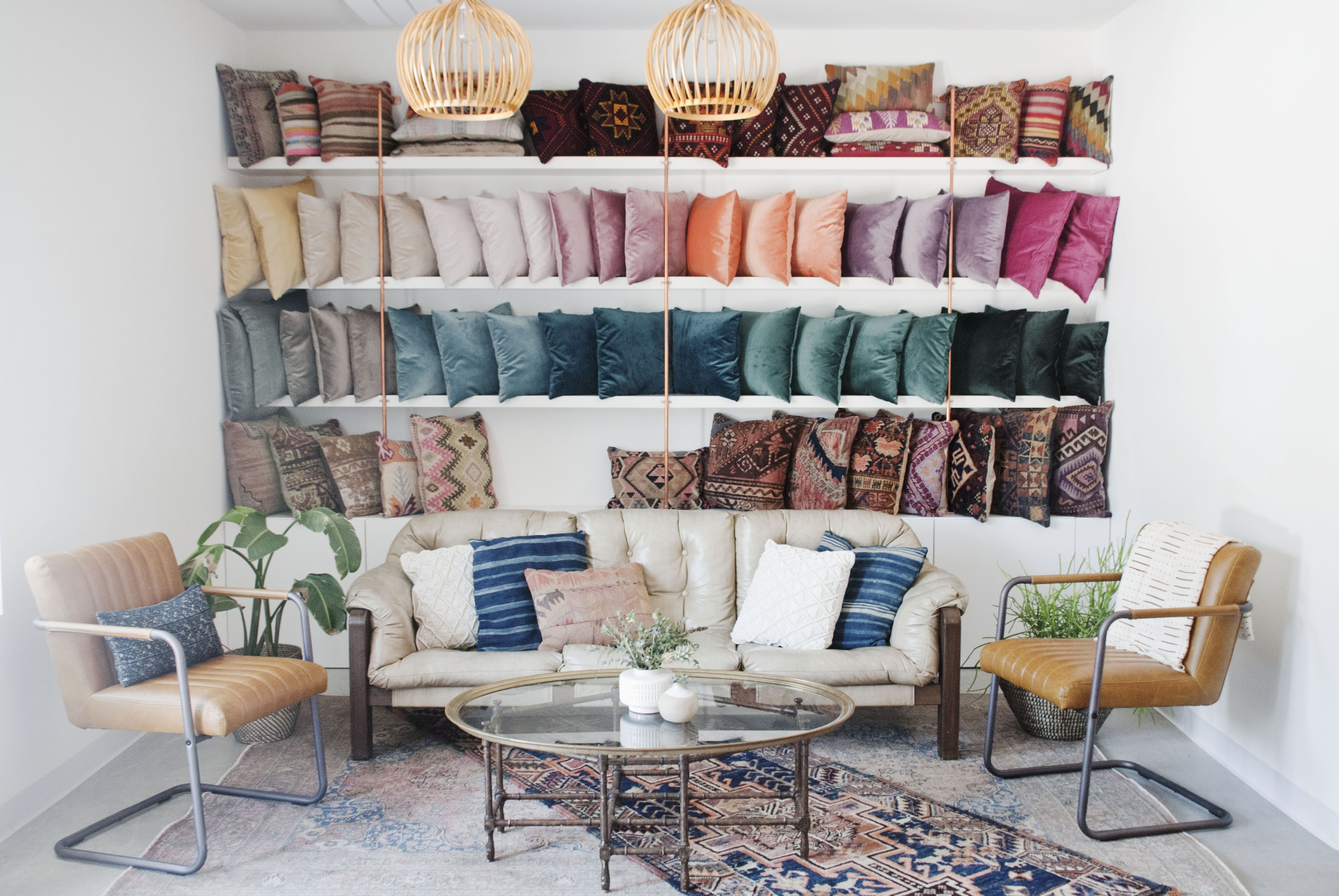 Rental Company Warehouse Showroom With A Pillow Wall And Neutral Leather Furniture Via Birch Brass Vintage Rent Furniture Showroom Furniture Trendy Furniture
