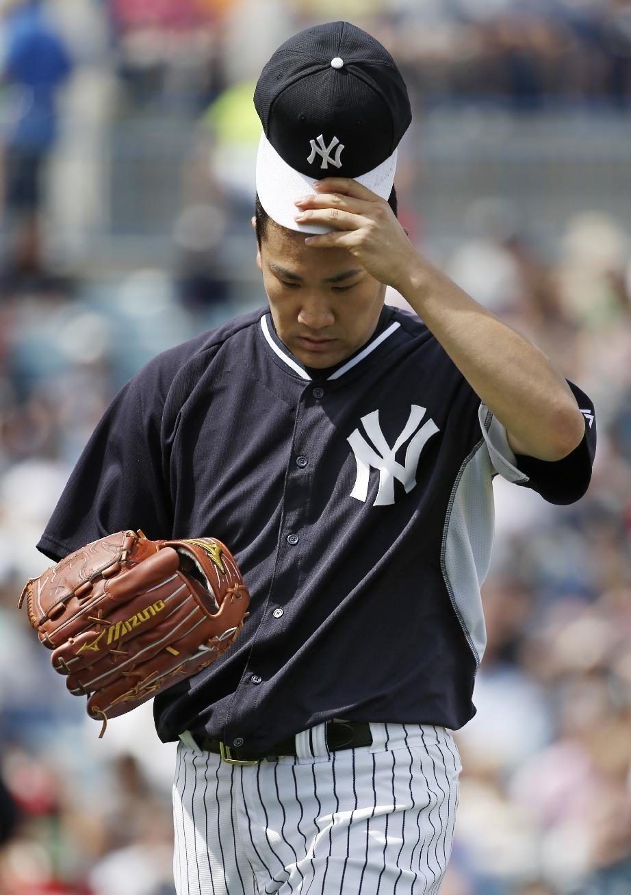 New York Yankees starting pitcher Masahiro Tanaka tips his