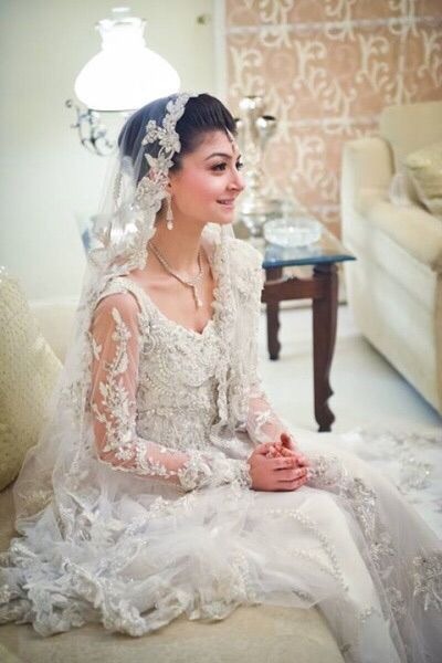 White Georgette with lace veil to embrace the traditional American ...