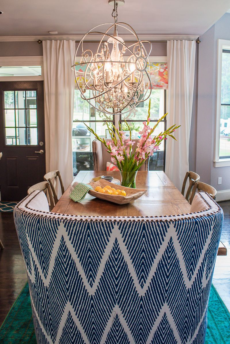 A Colorful Chic Breakfast Room Featuring Navy White Ikat Wingback End Chairs And
