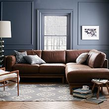 West Elm Henry leather sectional: clean lines and the warm leather are casual and would work well in your space. We could add two side chairs in a pattern with a more curved shape to balance the edges...