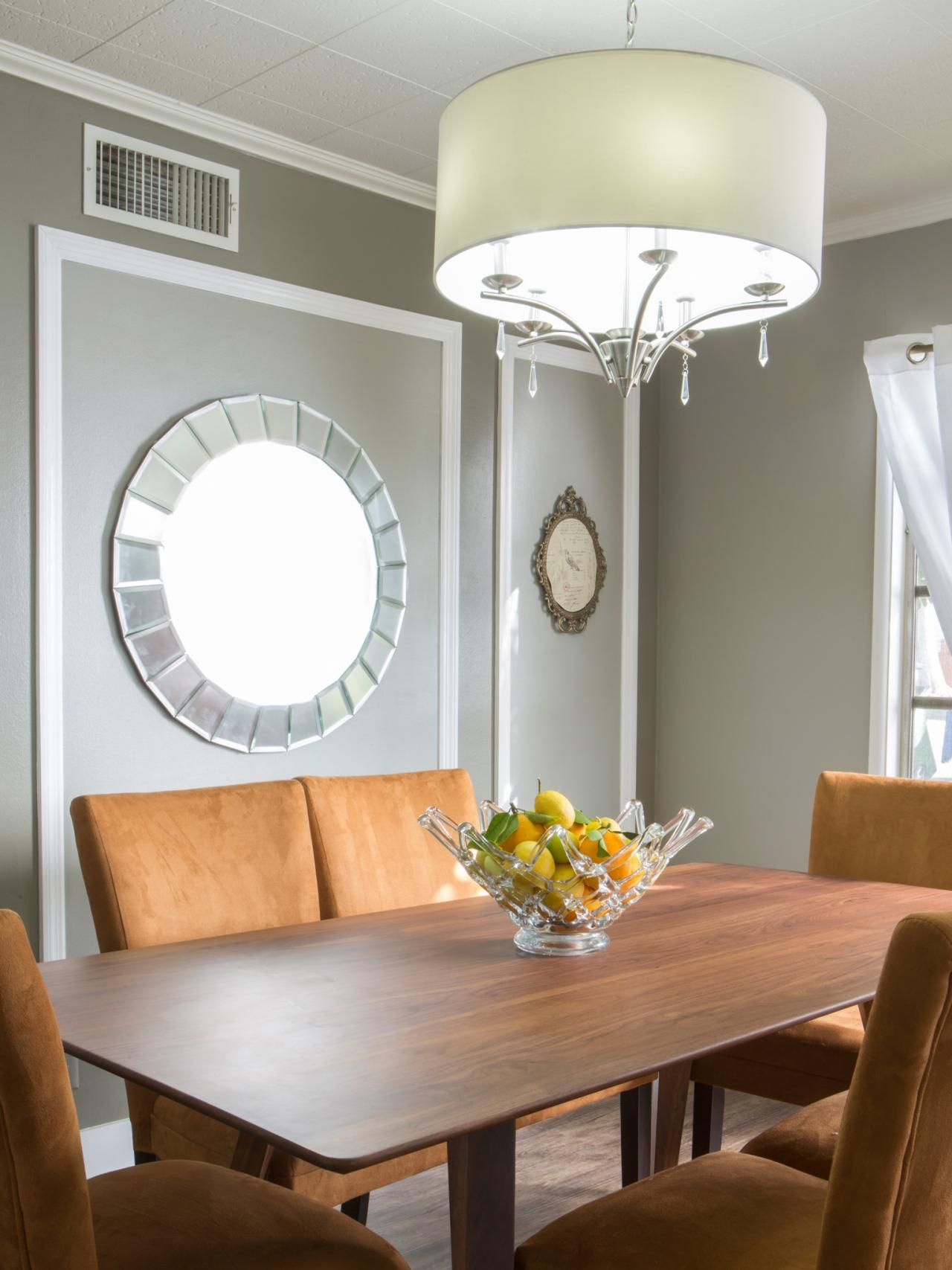 A Transitional Dining Room Features White Crown Molding And Wall Perfect Complement To