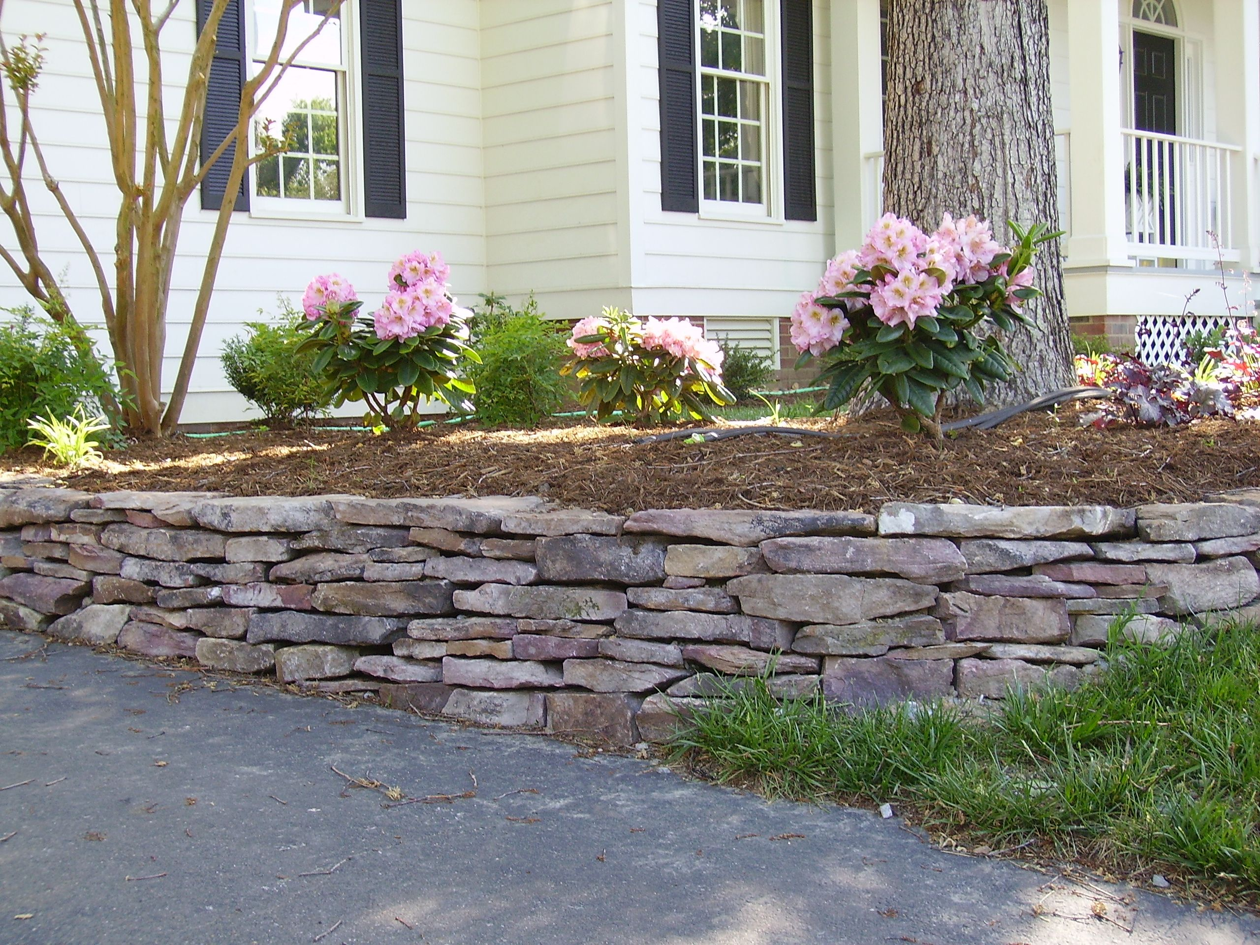 Pin By Scott On Stacked Stone Stone Walls Garden Patio Landscaping Front Landscaping