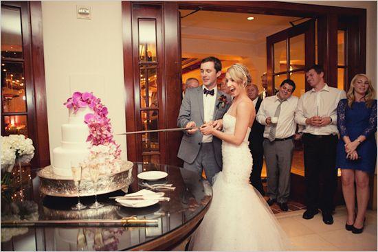 Colorful Coastal Destination Wedding Cake CuttingGold