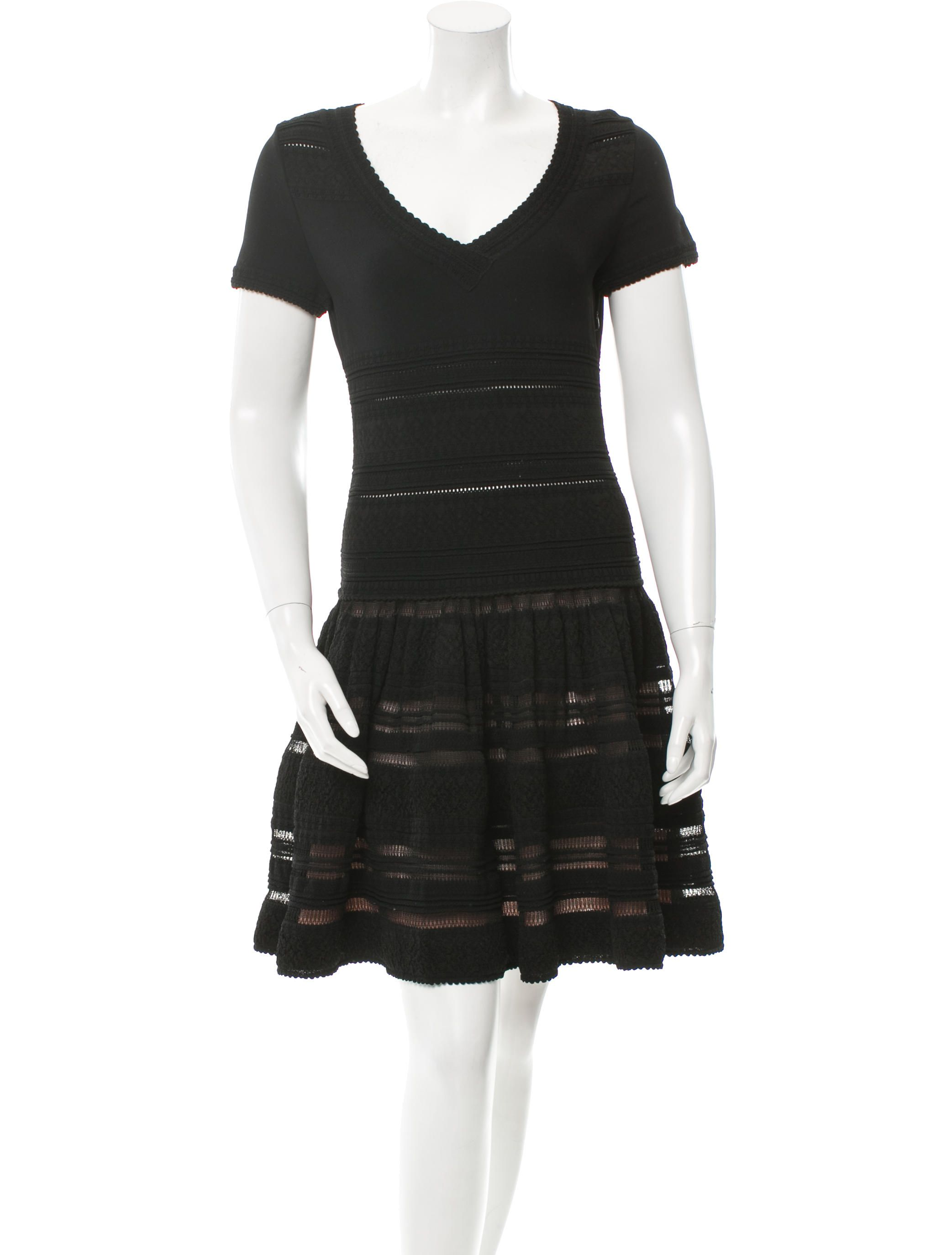 a03276c3 Black Alaïa stretch knit dress with V-neck, drop waist, nude underlay at  open knit skirt and concealed zip closure at side seam.