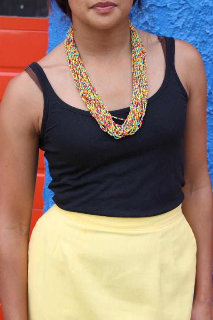 thrifted yellow midi skirt, black tank top, beaded necklace