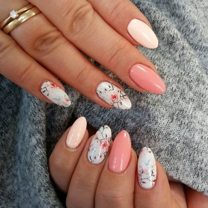 Light Nail Polish In Blue Decorated With Floral Motifs And In Two Shades Of Pink On Two Han Almond Shaped Nails Designs Almond Acrylic Nails Spring Nail Art