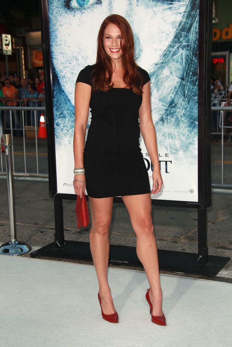 Amanda Righetti showing her fit body and nice legs in a little black dress.