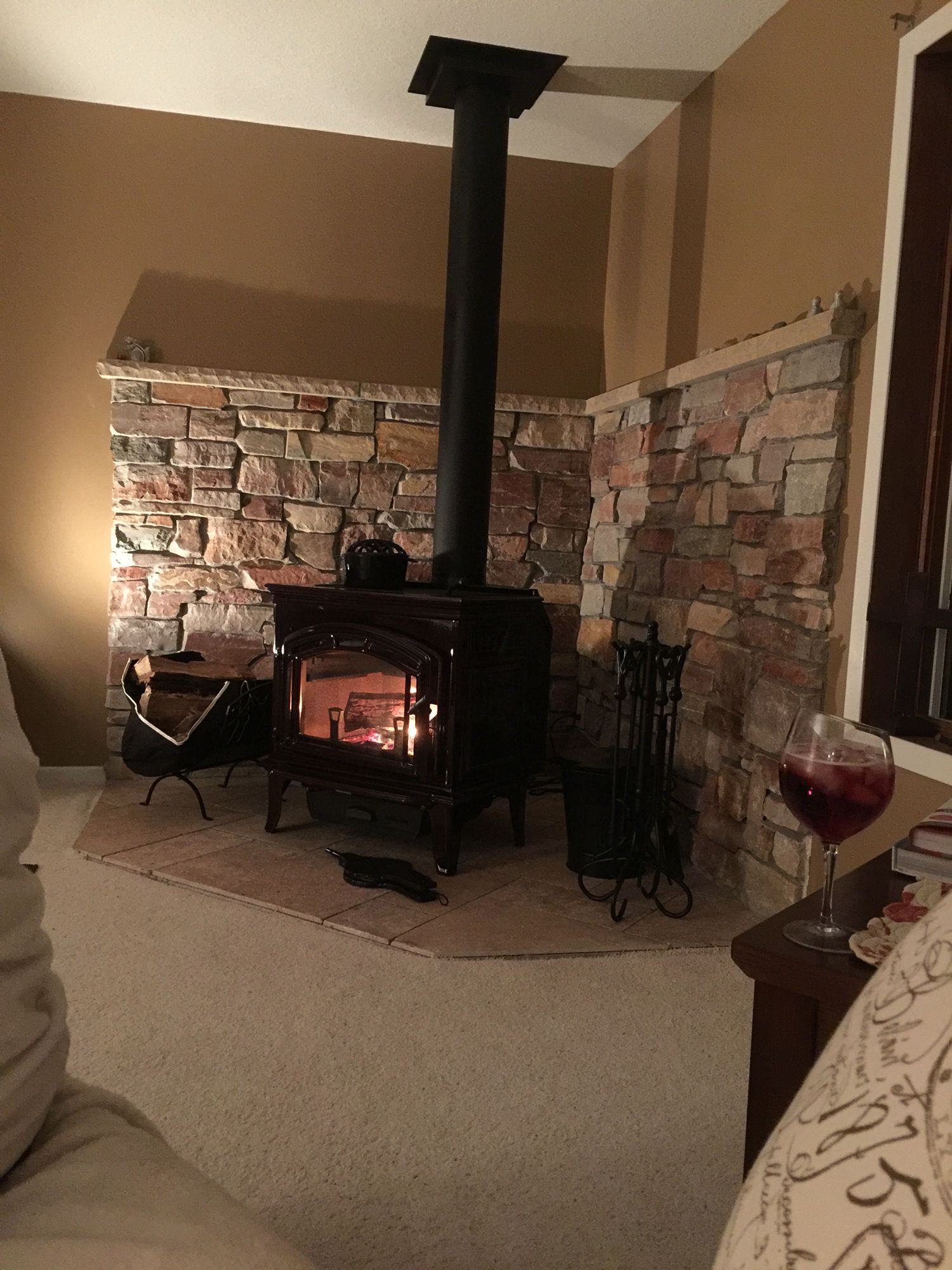 our new wood stove and rock wall will be doing the carpet to tile
