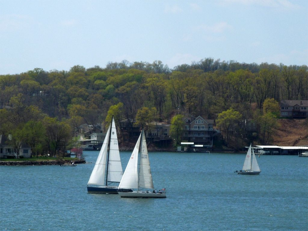 Sailboats on lake of the ozarks on a warm march saturday