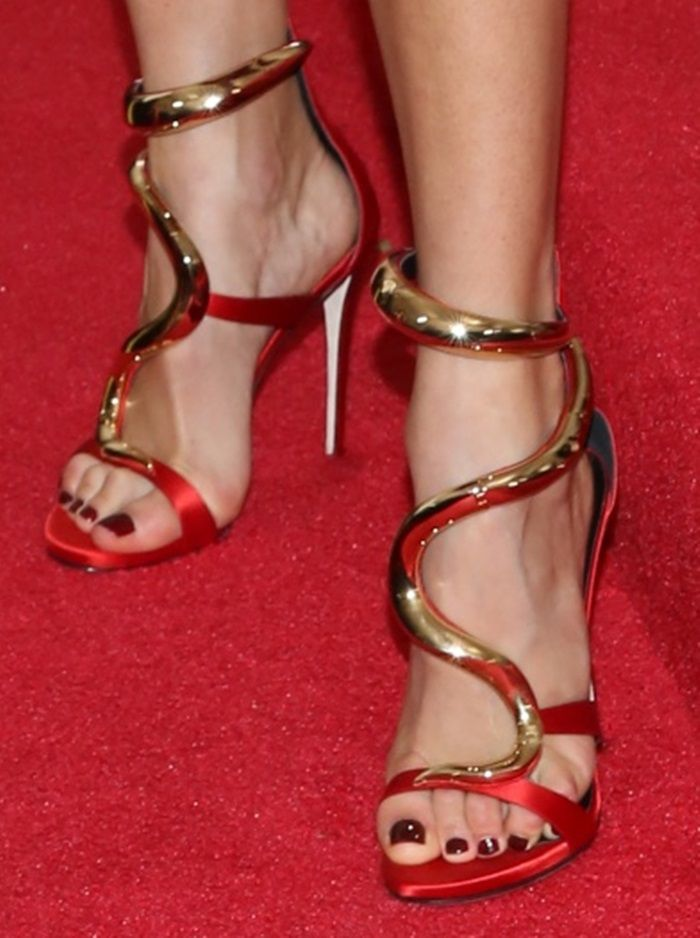 b3501db20e8 Karolina Kurkova shows off her sexy feet in red satin Venere sandals ...