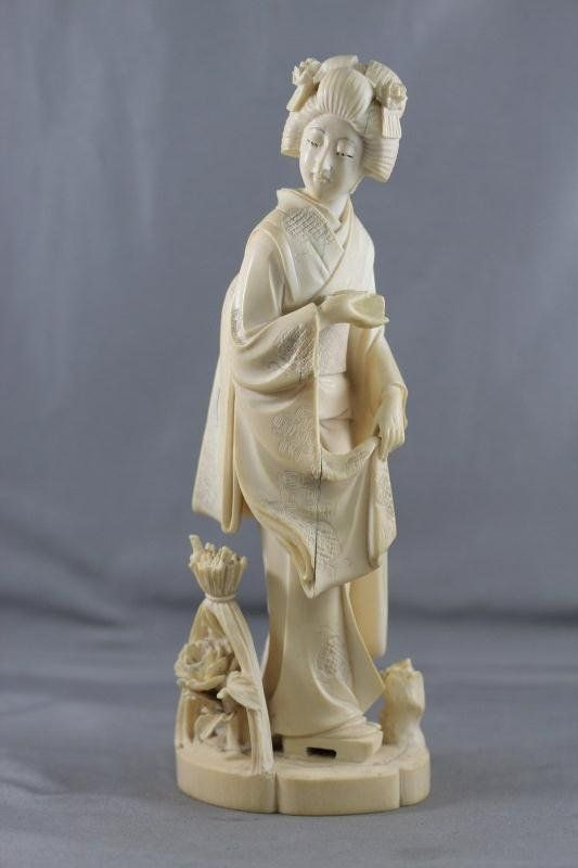 Japanese Carved Ivory Figure of a Geisha depicted wearing kimono, holding box in hand,h 21cm