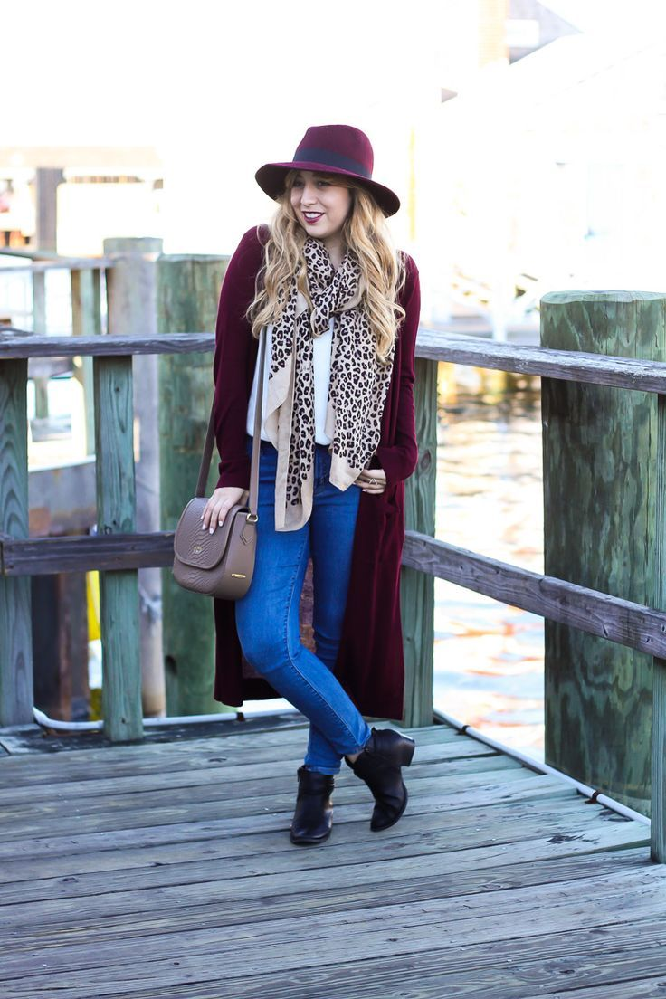 d3d8ae43ef Miami fashion blogger Stephanie Pernas wearing a wine colored fedora with a  long duster cardigan