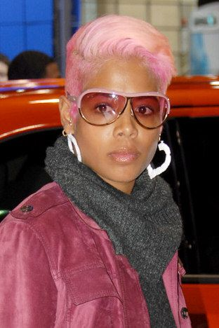 Pink Hair And Heart Shaped Earrings With A Scarf Around Her Neck For