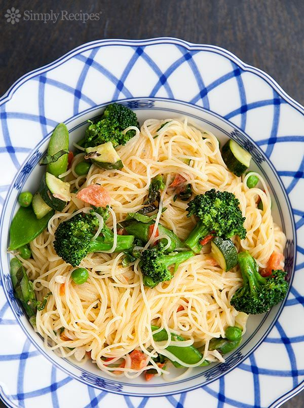 Classic Pasta Primavera ~ Angel hair pasta with a butter, cream, Parmesan sauce, and plenty of fresh vegetables - broccoli, zucchini, asparagus, snow peas, tomatoes, garlic and basil. ~ SimplyRecipes.com