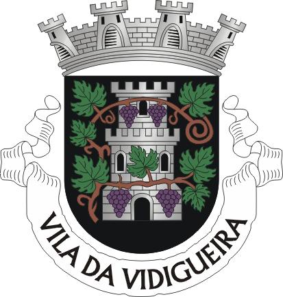 """Heraldry of the World Civic heraldry of Portugal - Brasões dos municípios Portugueses - Official blazon  Escudo de negro, com uma torre torreada de prata aberta e iluminada do campo, envolvida por uma videira troncada da sua cor, folhada de verde e frutada de púrpura. Coroa mural de prata de quatro torres. Listel branco com os dizeres : """" VILA DA VIDIGUEIRA """" de negro."""