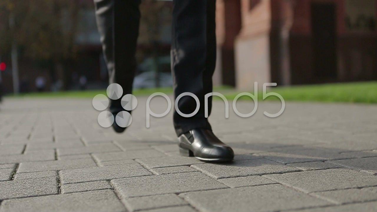 Businessman Walking On The Sidewalk 2 Stock Footage Ad Walking