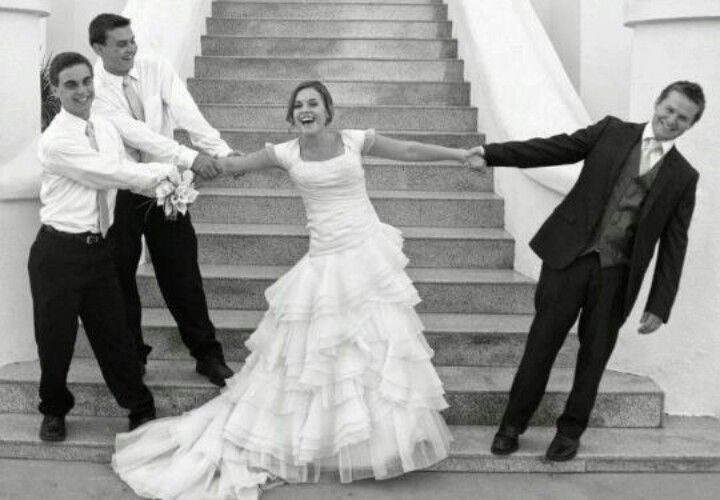 Brothers and husband fighting for the bride. The is a must must must do with Gatlin me and Ryan!  (Gatlin my little brother and Ryan my groom) the three of us just talked bout doing this!!!! Love it so much!!!!!