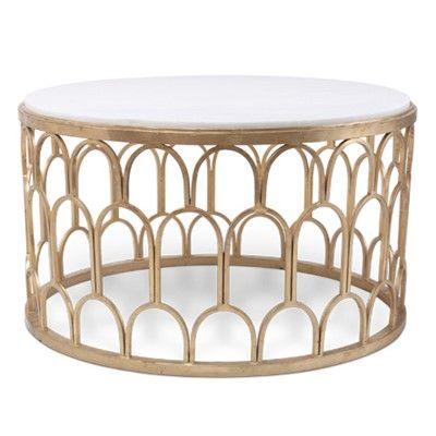 """Bliss Studio Dunand Gold Coffee Table;an antique gold-finished, scaled form, this round furnishing showcases an elegant white marble top. 33.5"""" Diameter x 20""""H Wipe down with soft, dry cloth to clean; $1445"""
