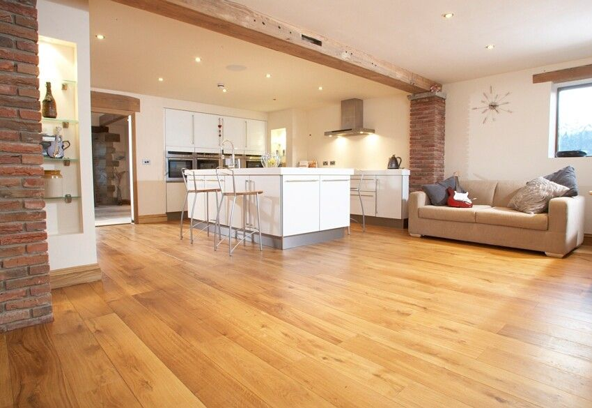 Character solid oak flooring in open plan living room for Hardwood floor plans