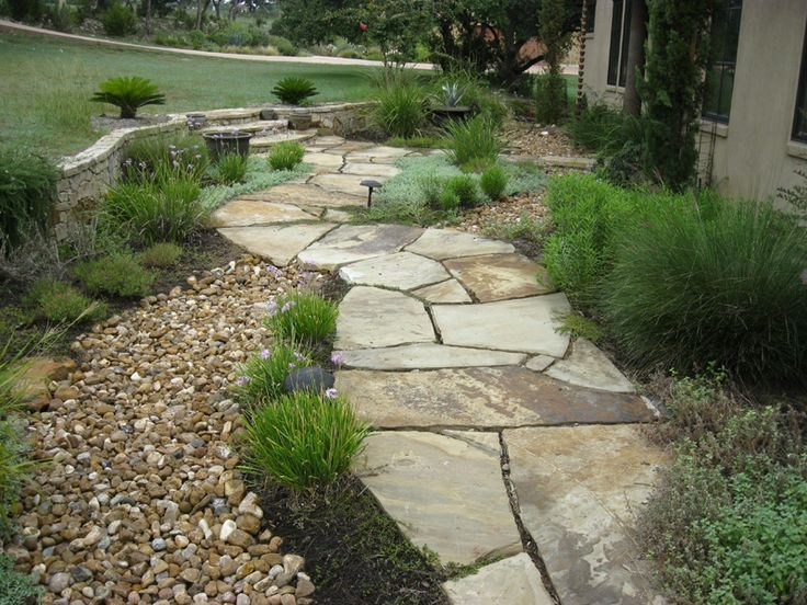 Dry creek bed landscaping border austin lawn drainage for Dry landscape design