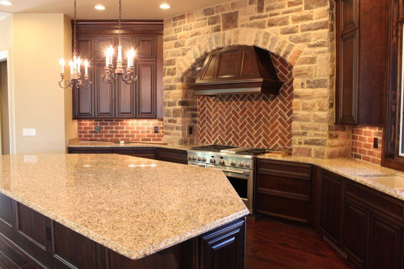 Great Kitchen By The Jae Company Featuring Starmark Cabinetry Arlington And A  Brick Oven Inspired Backsplash