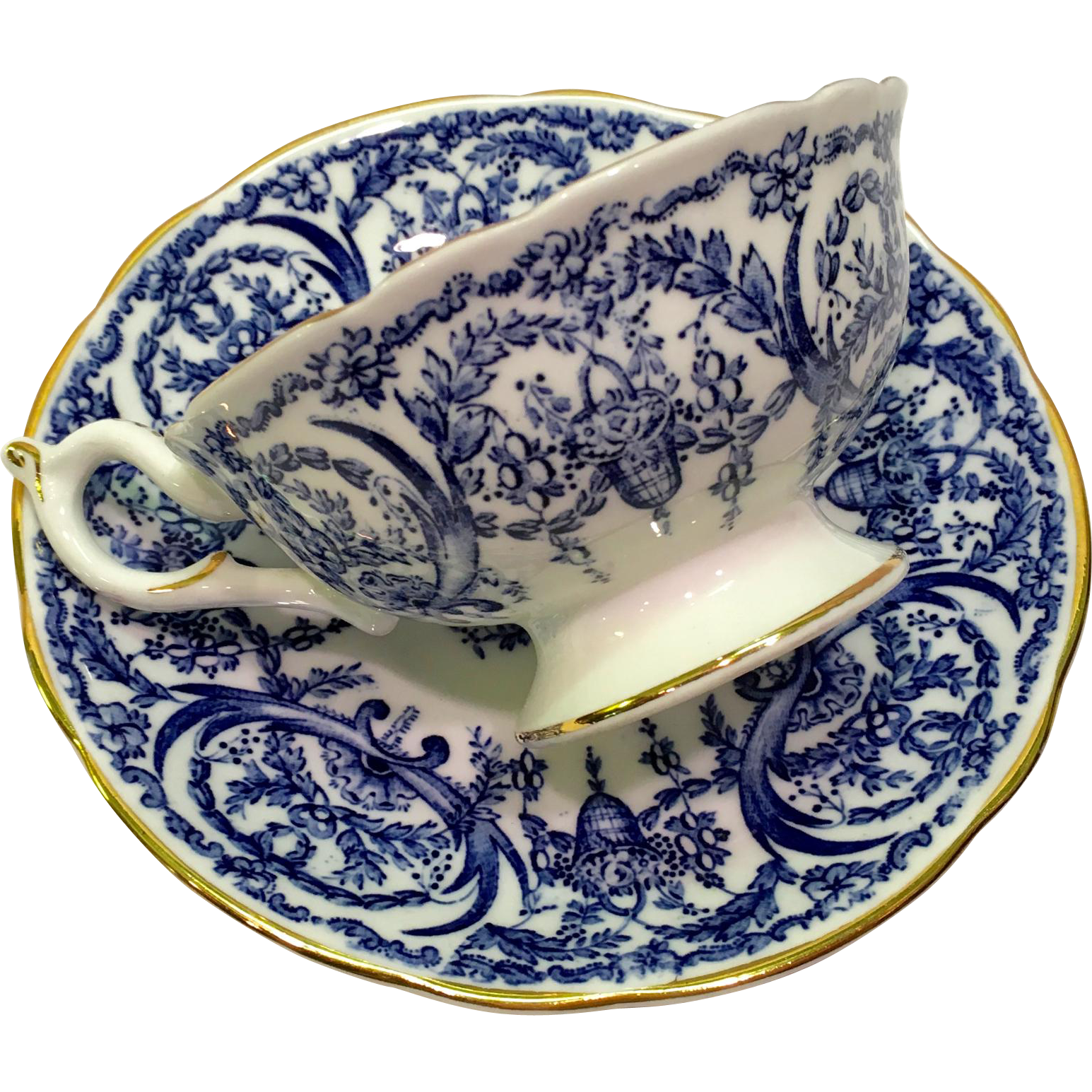 This Cobalt Blue and White Coalport Bone China Basket and Garland #5012F Teacup and Saucer is simply exquisite! The intriguing floral and basket