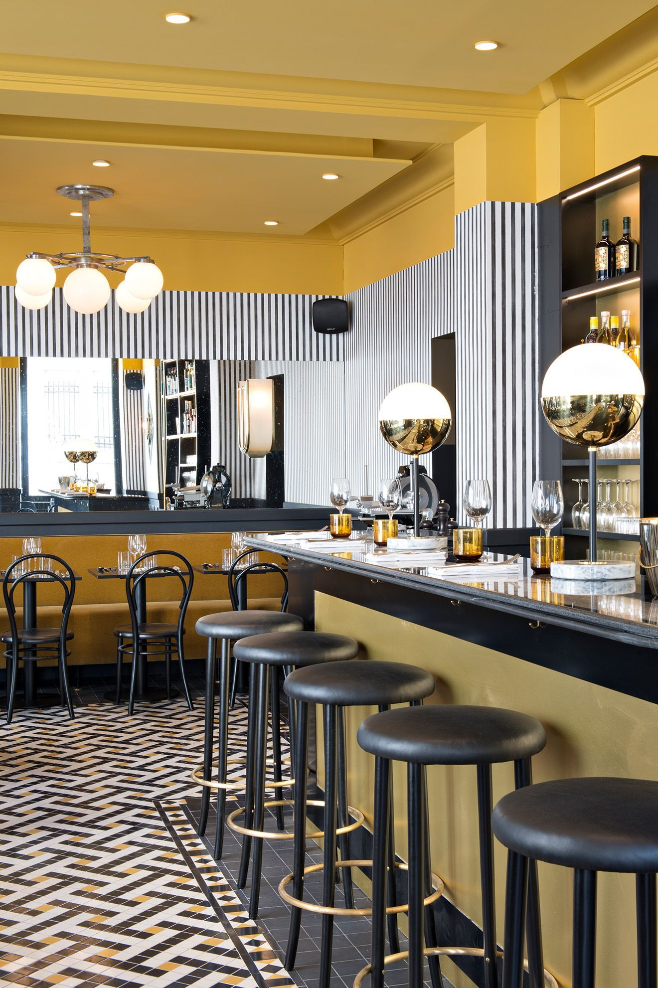 Black And White Striped Wallpaper With Decorative Tiled Floor Featuring Hints Of Mustard To Reflect The Re Design Interieur Restaurant Deco Restaurant Art Deco