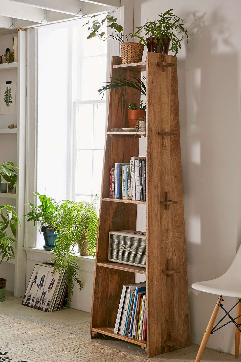 Lean and clean: A rustic wood shelf takes tusk-and-groove construction to a new level. Perfect as a bookcase of display shelf.