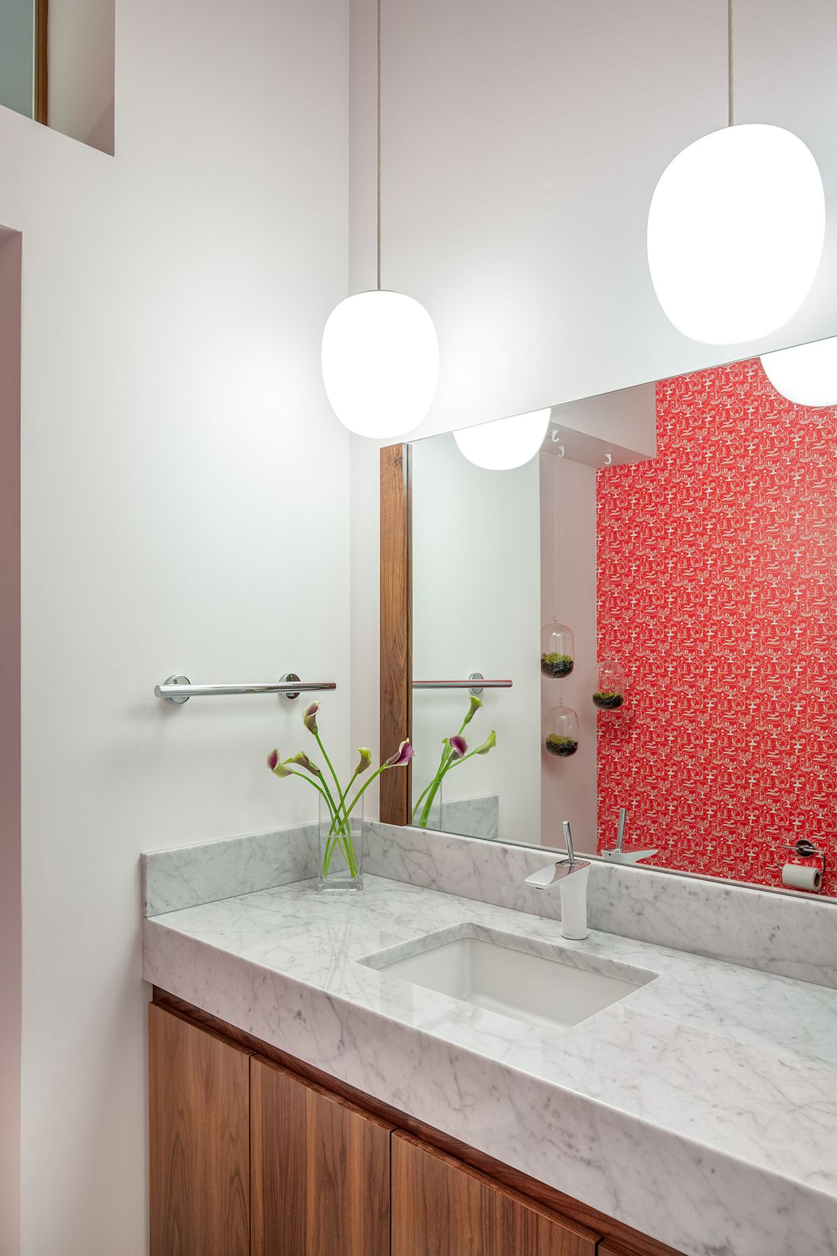 Modern powder room with wallpaper accent wall. Design