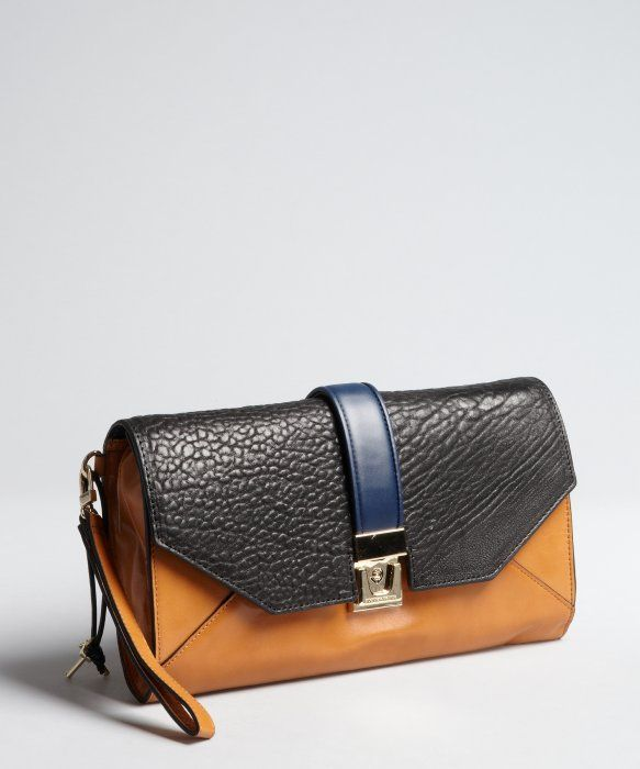 BCBGMAXAZRIA Leather Clutch Bag This is a need.