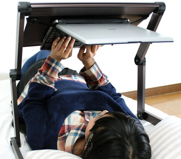 Are You Lying Down And Try To Use Your Laptop? Perhaps This Adjustable Laptop  Stand Is The Innovation That We Have Been Waiting For. A New Way To Work  More ...