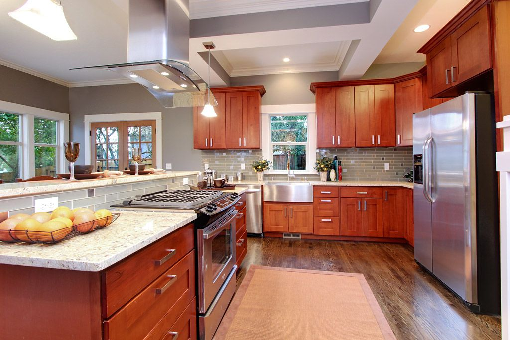 Kashmir cream granite with natural cherry kitchen cabinets for Cherry and white kitchen cabinets