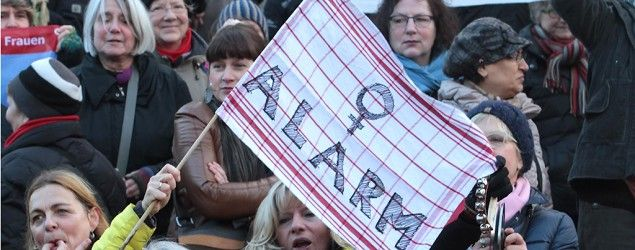 Participants in a women's flash mob demonstrate against racism and sexism in Cologne, Germany. (Juergen Schwarz/ AP Photo)