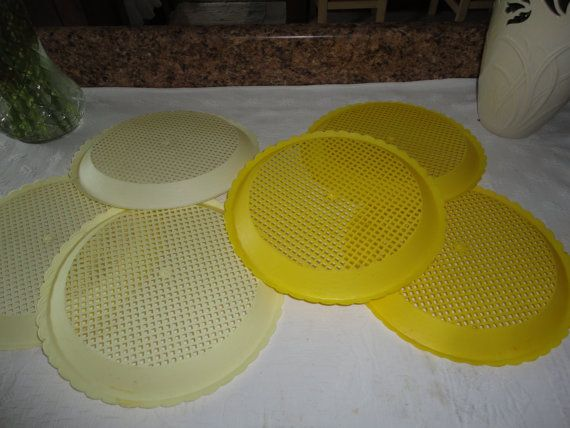 Set of 6 paper plate holders. They are a light and dark yellow plastic & Set of 6 paper plate holders. They are a light and dark yellow ...