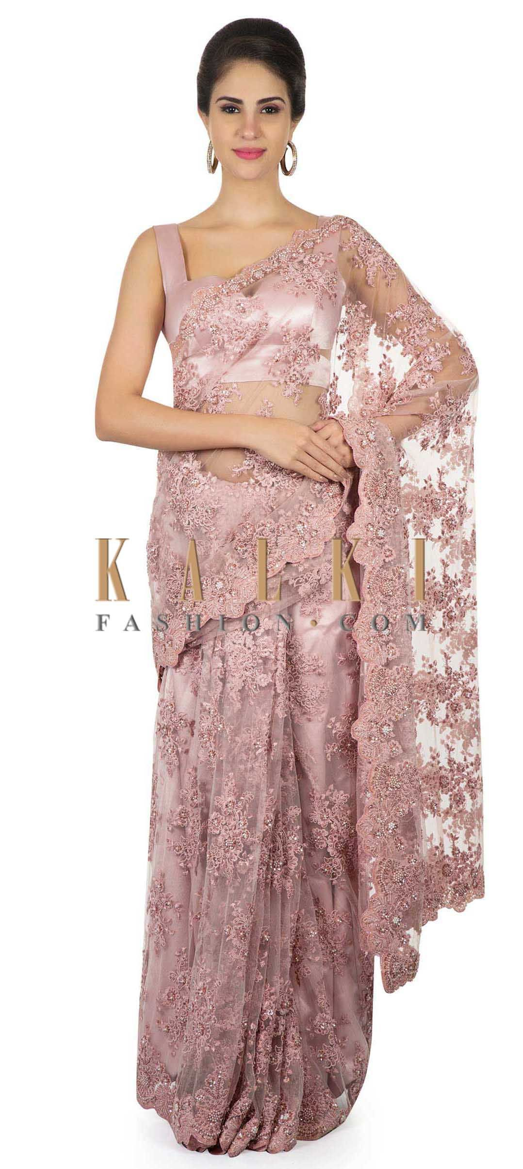 63adf5153 Pink embroidered net saree with scalloped border only on Kalki in ...