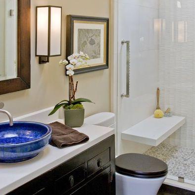 pebble floor tile & floating bench. shower designs for