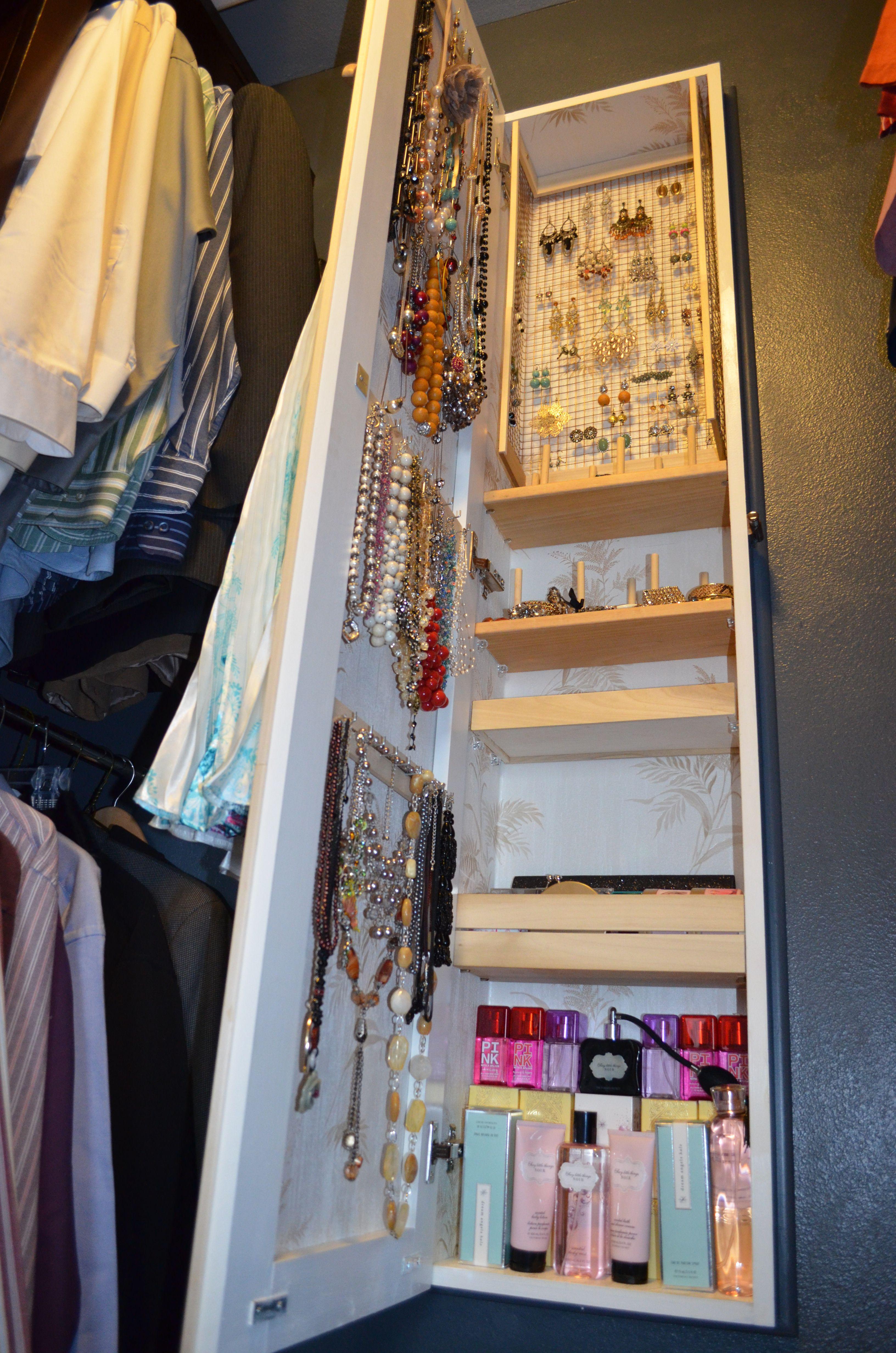 jewelry armoire in a master closet built between studs between