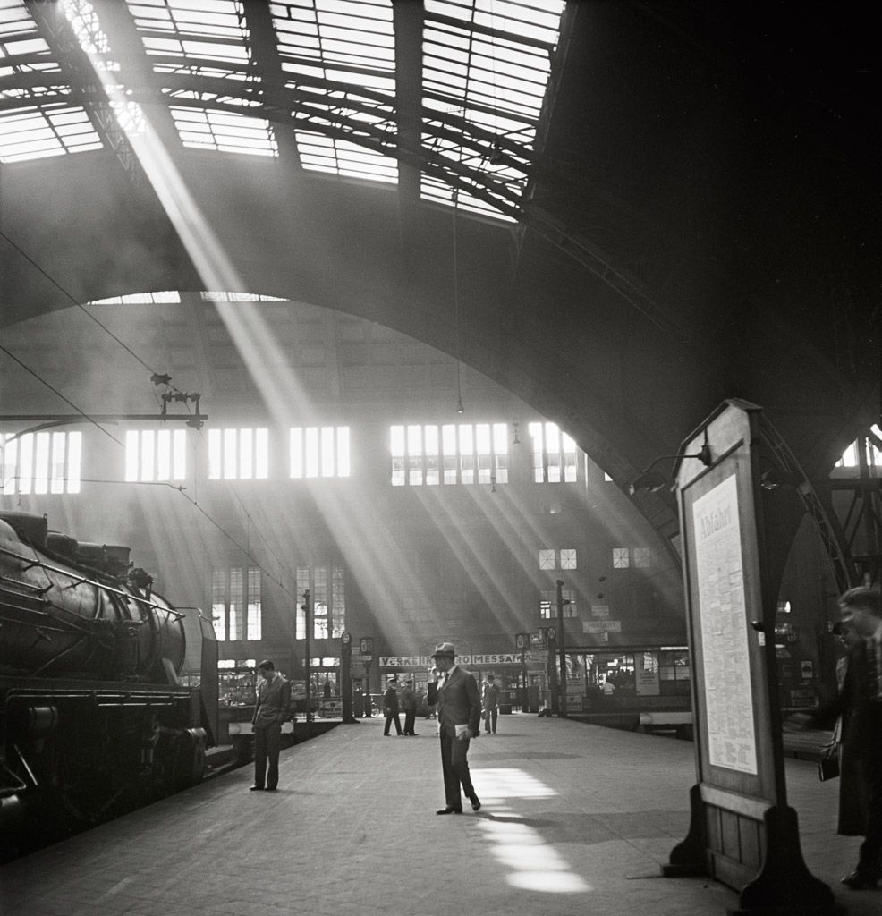 Amazing Roman Vishniac Sunlight streaming into a railway station probably the Bahnhof Zoo terminal in Charlottenburg Berlin late early