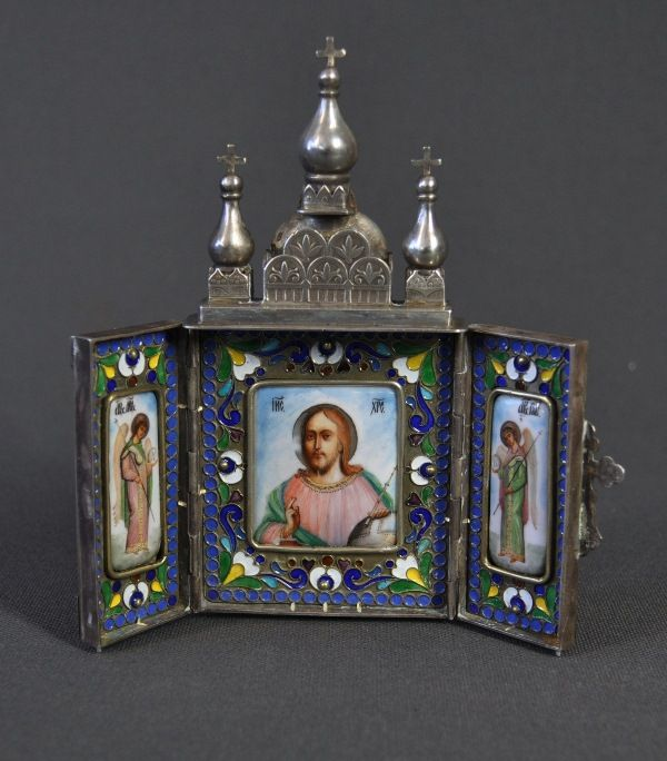 Russian Mikhail GRACHEV Silver Travelling Icon. Hallmarked St Petersburg 1907-1926, Mikhail Grachev. Triptych form, opens to painted porcelain panels of Christ Pantocrator flanked by 2 archangels in champleve enamel settings. H13cm W13cm pae 4-6