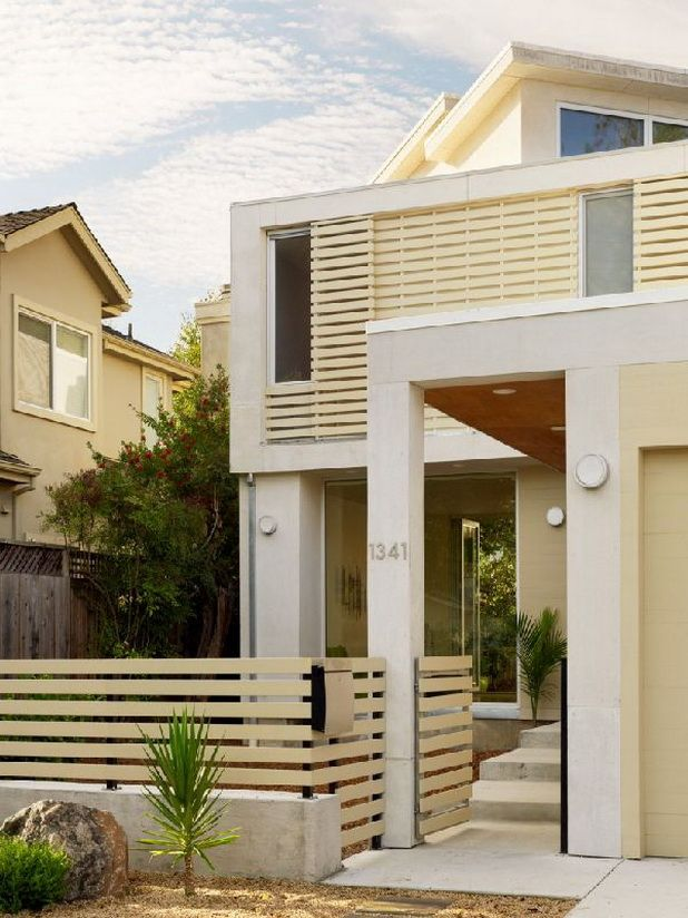 Fascinating Architecture Front View Of Modern Creamy Home Design With Wooden Ornament Enticing