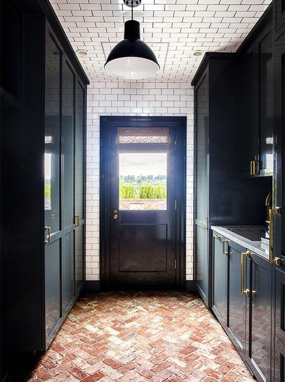 Dark Cabinets Subway Tile Ceiling And Herringbone Brick