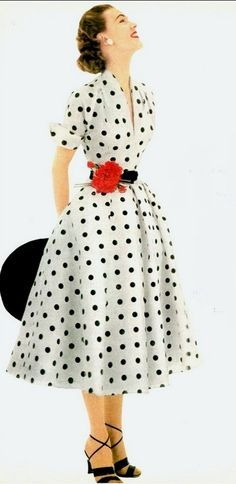 5e9ee69f47a 1952 Model in white and black polka-dotted dress of silk shantung by Donald  Dress