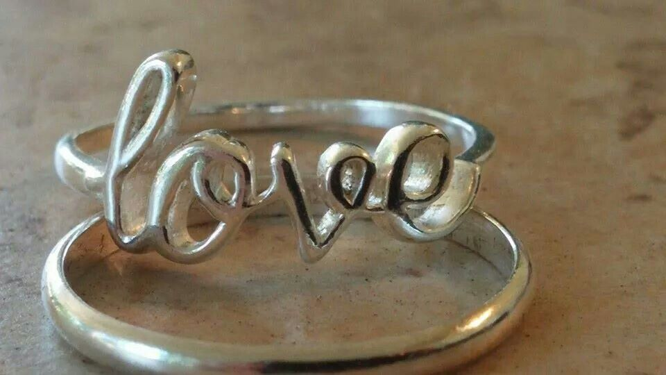 Sterling Silver script love ring. $20