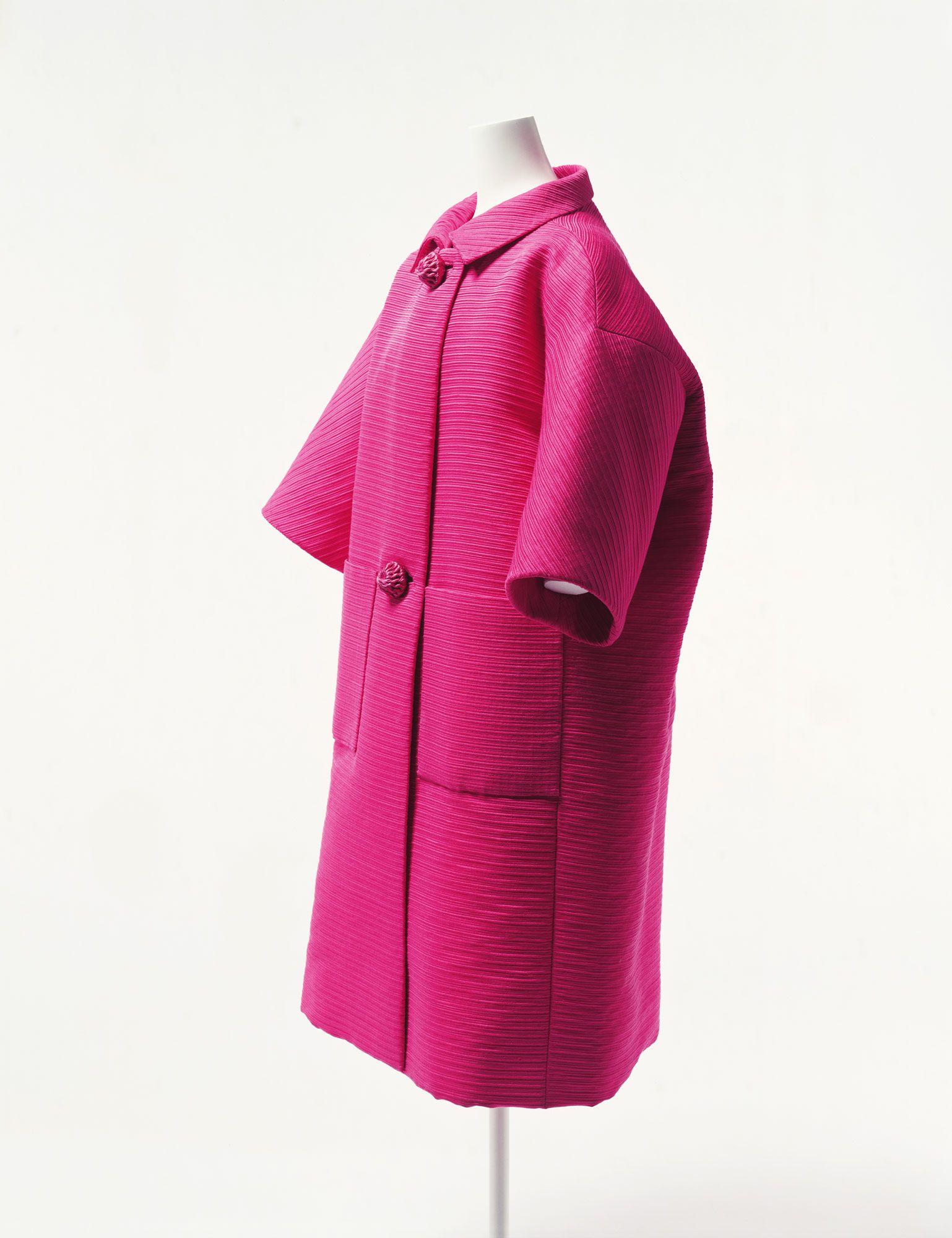 Coat1,955 Designer: Cristobal Balenciaga Brand: Balenciaga Label: BALENCIAGA 10, AVENUE GEORGE V PARIS Material: Fuchsia silk ottoman woven with striped pattern; cord-wrapped buttons.