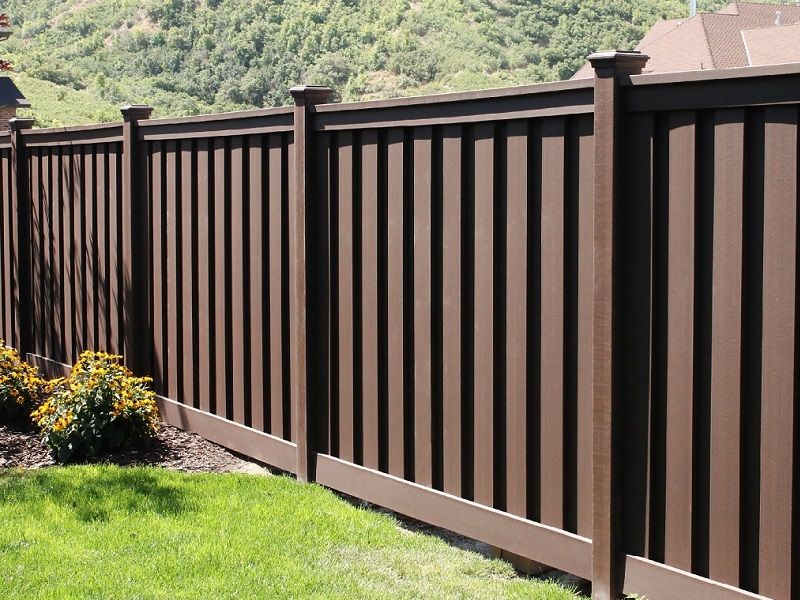 Beautiful Dark Brown Fence With Flat Caps For A Yard Or