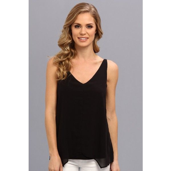Look chic and sophisticated in this refined Kenneth Cole New York top. Top is fabricated from a smooth jersey with a delicate chiffon overlay. Double-layer con…